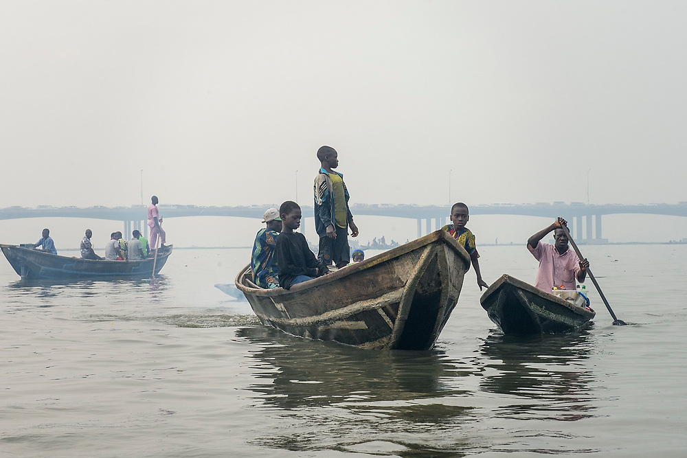 Fishermen returning to Makoko