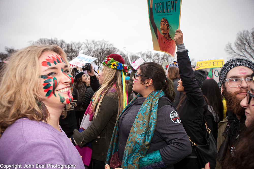Protesters danced and sang in the street to music provided by Sisters of Liberty, on the corner of 7th and Madison, near the National Mall, during the Women's March on Washington where an anticipated 200,000 people turned into an estimated 500,000 to 1 million people, on Saturday, January 21, 2017.  John Boal Photography