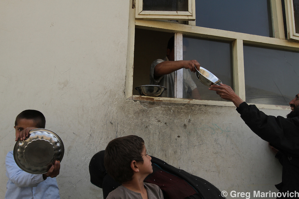 Kabul, Afghanistan, October 12, 2010. Afghan civilians get food assistance. Photo Joao Silva.