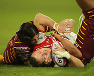 Jake Mamo of Huddersfield Giants tackles James Roby of St Helens during the Betfred Super League match at the John Smiths Stadium, Huddersfield<br /> Picture by Stephen Gaunt/Focus Images Ltd +447904 833202<br /> 23/02/2018