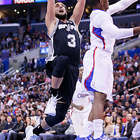 18 February 2014: San Antonio Spurs shooting guard Marco Belinelli (3) goes for the layup past Los Angeles Clippers point guard Chris Paul (3) during the San Antonio Spurs 113-103 victory over the Los Angeles Clippers at the Staples Center, Los Angeles, California, USA.