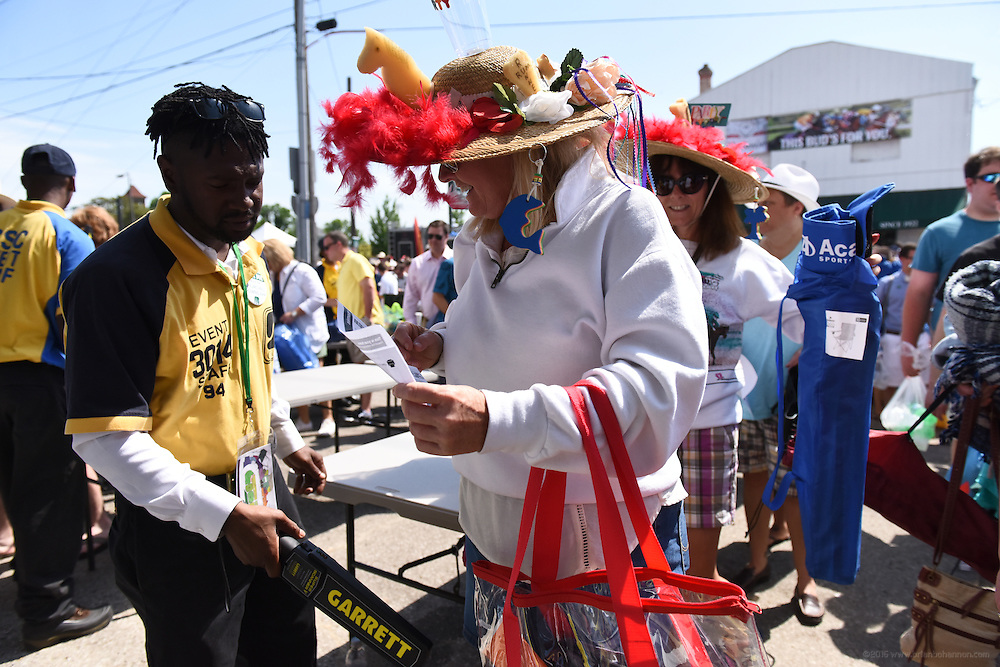 Andrew Doehring of Ft. Knox, Ky., left, wands race fans at Gate 3, the entrance to the infield for the 142nd running of the Kentucky Derby. May 7, 2016