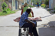 Bicitaxi hauling a pig in Holguin,Cuba.