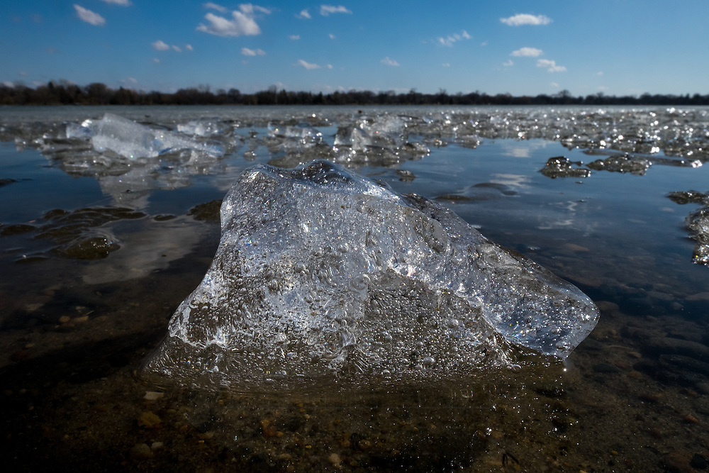 During the late winter- early spring thaw, the ice breaks apart into little ice chunks that float freely in the water.