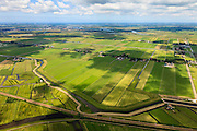 Nederland, Noord-Holland, Gemeente Purmerend, 14-06-2012; polder Wijdewormer, droogmakerij uit de 17e eeuw. Linksonder de Polder Purmerland, de onregelmatige verkaveling in dit gebied is het resultaat van veenontginning en vorm een tegenstelling met de regelmatige verkaveling van de droogmakerij..On the right Wijdewormer polder, reclaimed land dating from the 17th century. On  the left Purmerland polder, the division in plots in the area is the result of peat extraction..luchtfoto (toeslag), aerial photo (additional fee required);.copyright foto/photo Siebe Swart
