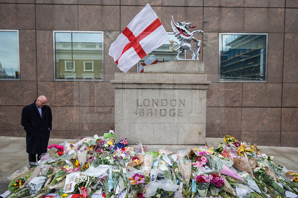 © Licensed to London News Pictures. 08/06/2017. London, UK. Floral tributes continue to be left at London Bridge where eight people lost their lives in a terrorist attack on the evening of Saturday 3 June 2017. Photo credit: Rob Pinney/LNP