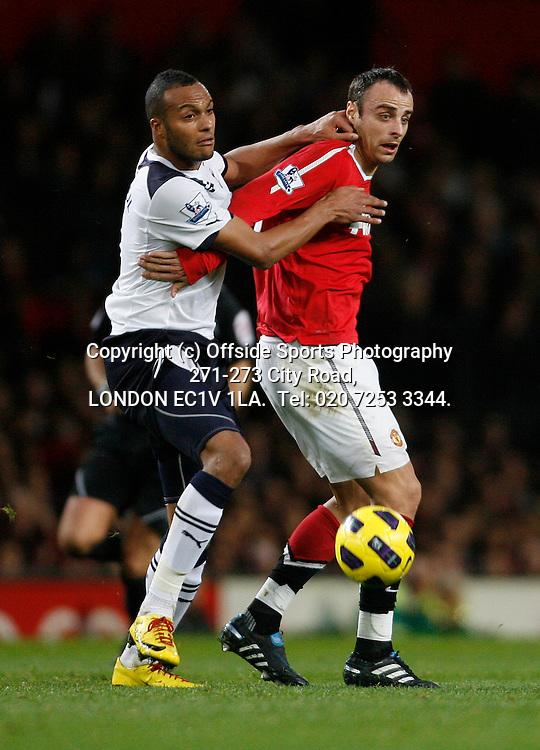 30/10/2010 Manchester United v Tottenham Hotspur, Barclays Premier League.<br /> Dimitar Berbatov and Younes Kaboul<br /> Photo: Mark Robinson.
