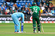 Jonny Bairstow of England and Mohammad Saifuddin of Bangladesh look at the ball which hit the stumps but didn't dislodge the bails during the ICC Cricket World Cup 2019 match between England and Bangladesh the Cardiff Wales Stadium at Sophia Gardens, Cardiff, Wales on 8 June 2019.