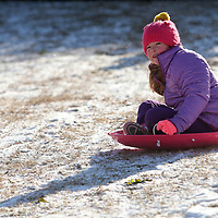 With a big push from her dad, Ben, Vivian Galjour, 7 of Tupelo, sleds down the hill behind Church Street School on Wednesday morning.