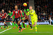 AFC Bournemouth goalkeeper Artur Boruc gathers the ball watched by AFC Bournemouth forward Joshua King during the Barclays Premier League match between Bournemouth and Southampton at the Goldsands Stadium, Bournemouth, England on 1 March 2016. Photo by Graham Hunt.