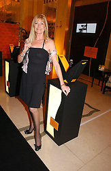 Former winner DEBBIE MOORE at a reception for the winners of the 2006 Veuve Clicquot Award - Business Woman of the Year held at Claridge's Hotel, brook Street, London on 27th April 2006.  This years winner was Vivienne Cox, BP CEO for Gas, Power, Renewables and Integrated Supply & Trading.  The awards were presented by the Rt.Hon.Gordon Brown MP - The Chancellor of the Exchequer.<br />