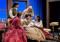 "Beth March (Jenny Burke), Jo March (Calista Morris), Amy March (Sophia Joyal) and Meg March (Heather Hunt) gather around Mrs. March (Zoe Cygan) for a scene of ""Little Women"" at the Winnipesaukee Playhouse during Tuesday evening's dress rehearsal.  (Karen Bobotas/for the Laconia Daily Sun)"
