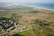 Nederland, Noord-Holland, Texel, 14-07-2008; tenten en caravans op camping de Sluftervallei, vernoemd naar natuurreservaat De Slufter (linksboven); kamperen, duin, duinen, Noordzeekust. .luchtfoto (toeslag); aerial photo (additional fee required); .foto Siebe Swart / photo Siebe Swart