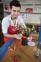 Florist gift wraps houseplant