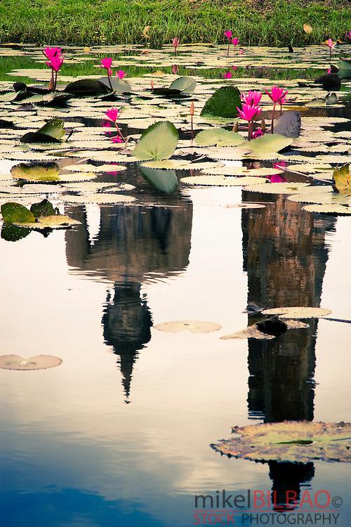 Buddha statue and pool. Wat Mahathat. Sukhothai Historical Park. Thailand.