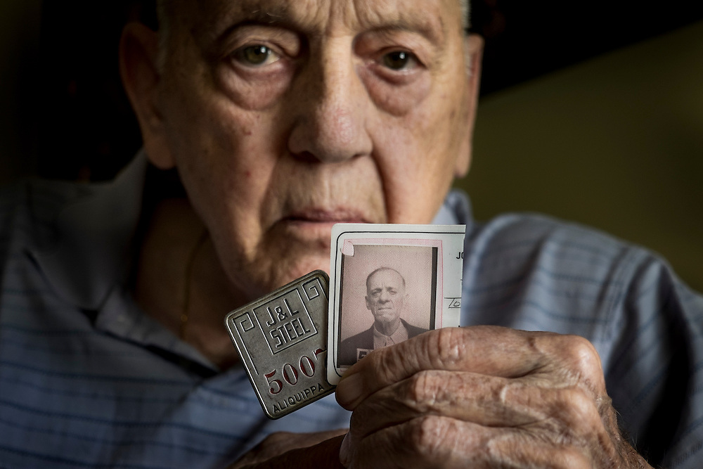 Pete Marovich, Sr., holds his father's Jones and Laughlin Steel Company ID card and badge on June 7, 2015 near Aliquippa Pa., USA. The company cut Tom Marovich's ID card in half upon his retirement after 37 years at the Aliquippa Works.