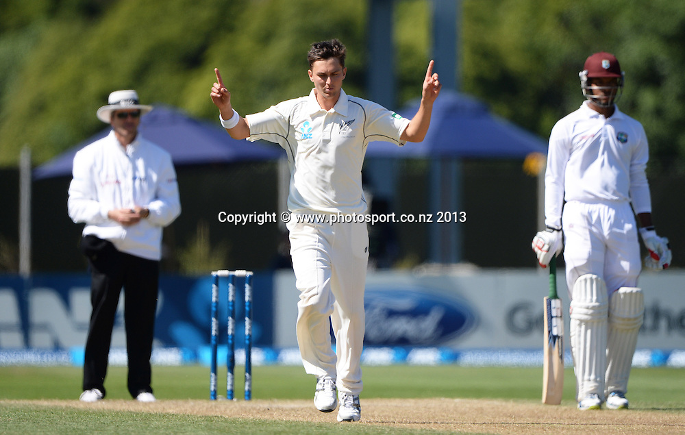 Trent Boult celebrates the wicket of Kirk Edwards on Day 2 of the 1st cricket test match of the ANZ Test Series. New Zealand Black Caps v West Indies at University Oval in Dunedin. Wednesday 4 December 2013. Photo: Andrew Cornaga/www.Photosport.co.nz