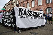 Frankfurt am Main | 05 July 2014<br /> <br /> Am Samstag (05.07.2014) demonstrierten in Frankfurt am Main etwa 250 Menschen aus der linksradikalen Szene gegen die deutsche Fl&uuml;chtlingspolitik, gegen Abschiebungen und f&uuml;r das Bleiberecht gefl&uuml;chteter Menschen in Deutschland und anderswo.<br /> Hier: Beginn der Demo auf dem Campus Bockenheim der Uni Frankfurt, Transparent &quot;Rassismus t&ouml;tet&quot;.<br /> <br /> [Foto honorarpflichtig, kein Model Release]<br /> <br /> &copy;peter-juelich.com