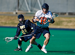 Virginia midfielder Garett Ince (15) and Navy midfielder Mikelis Visgauss (21) battle for possession.  The Virginia Cavaliers scrimmaged the Navy Midshipmen in lacrosse at the University Hall Turf Field  in Charlottesville, VA on February 2, 2008.