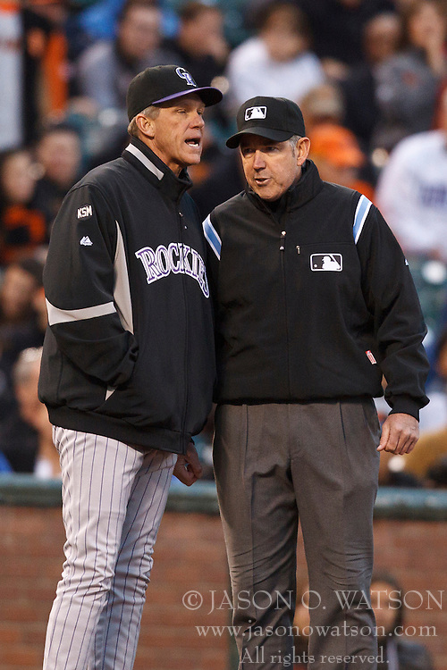 August 30, 2010; San Francisco, CA, USA;  Colorado Rockies manager Jim Tracy (4) argues with third base umpire Mike Winters (33) after second baseman Eric Young Jr. (3) was caught stealing third base against the San Francisco Giants during the first inning at AT&T Park.