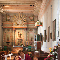 Specialists in art restoration work to repair the nearly 200 year old original artwork inside the San Miguel Mission church.