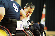 July 7th, 2006: Anchorage, AK - William Groulx (10) battles for a loose ball with  Blue team hard hitter Scot Severn (9) as White defeated Blue in the gold medal game of Quad Rugby at the 26th National Veterans Wheelchair Games.