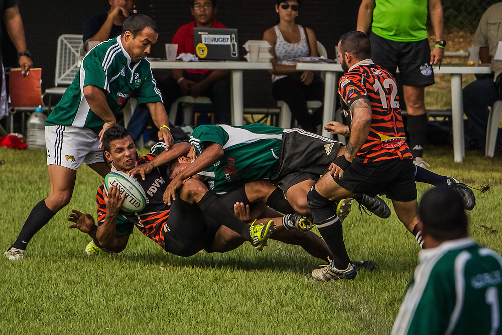Alcatraz team members (in green uniforms) compete in the biggest annual rugby tournament in Venezuela on Sunday, November 24, 2013. Santa Teresa rum company started the Alcatraz project as a way to help gang members living near the plantation to lead healthier lives through playing rugby and a work program.