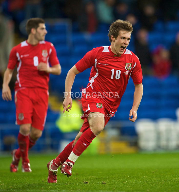 CARDIFF, WALES - Saturday, November 14, 2009: Wales' Aaron Ramsey celebrates scoring the third goal against Scotland during the international friendly match at the Cardiff City Stadium. (Pic by David Rawcliffe/Propaganda)