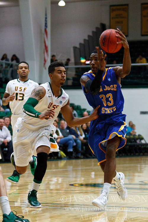 Nov 16, 2011; San Francisco CA, USA;  San Jose State Spartans guard James Kinney (33) dribbles past San Francisco Dons guard Michael Williams (5) during the second half at War Memorial Gym.  San Francisco defeated San Jose State 83-81 in overtime. Mandatory Credit: Jason O. Watson-US PRESSWIRE