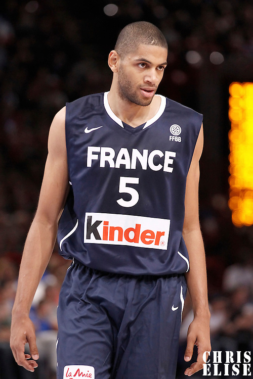 15 July 2012: Nicolas Batum of Team France rests during a pre-Olympic exhibition game won 75-70 by Spain over France, at the Palais Omnisports de Paris Bercy, in Paris, France.