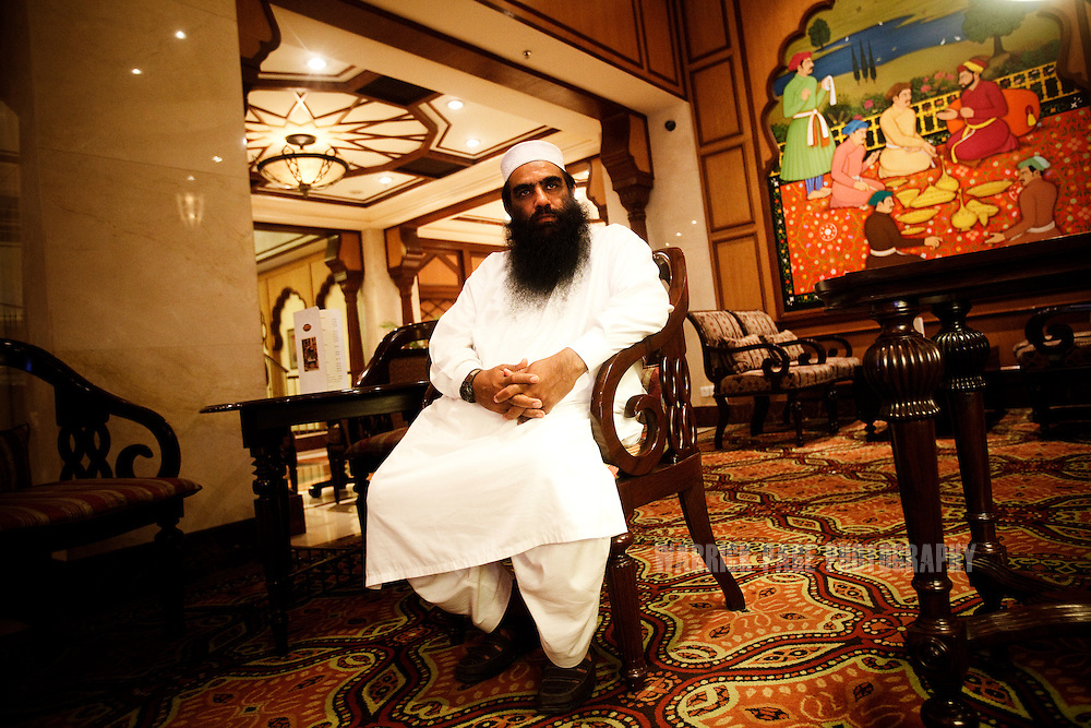 """LAHORE, PAKISTAN - MARCH 24: Jama'at-ud-Da'wah spokesman, Yahya Mujahid, sits for a portrait in the Avari hotel, on 24 March, 2011, in Lahore, Pakistan. Raymond Davis, a CIA contractor and former US soldier, shot and killed 2 Pakistan men on January 27, he claimed were armed and attempting to car-jack him in a busy intersection of Lahore. In spite of his diplomatic immunity, Davis was arrested, imprisoned and charged with murder before he was released on March 16, when the US government paid """"blood-money"""" to the victims' families. The incident sparked a major diplomatic furore, widespread protests and the deterioration of US-Pak ties, which would only further weaken in the coming months when Osama bin Laden was killed by US Navy Seals hiding in the Pakistani military garrison town, Abbottabad.  (Photo by Warrick Page)"""