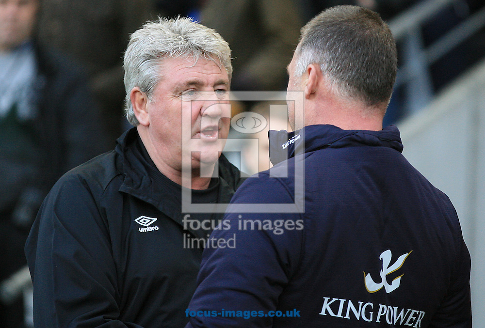 Steve Bruce Manager of Hull City greets Nigel Pearson Manager of Leicester City during the Barclays Premier League match at KC Stadium, Hull<br /> Picture by Richard Gould/Focus Images Ltd +44 7855 403186<br /> 28/12/2014