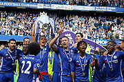 Chelsea FC celebrate with the trophy during the Premier League match between Chelsea and Sunderland at Stamford Bridge, London, England on 21 May 2017. Photo by Andy Walter.