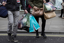 © Licensed to London News Pictures. 06/12/2012. London, U.K. Sales and Shoppers in London's Oxford street today (06/12/2012), People busy themselves with Christmas shopping in the aftermath of budget yesterday from the chancellor of the exchequer. Photo credit : Rich Bowen/LNP