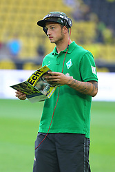 23.08.2013, Signal Iduna Park, Dortmund, GER, 1. FBL, Borussia Dortmund vs SV Werder Bremen, 3. Runde, im Bild Marko Arnautovic #7 (SV Werder Bremen) beim Lesen des Stadionheftes des BVB 09 // during the German Bundesliga 3rd round match between Borussia Dortmund and SV Werder Bremen at the Signal Iduna Park, Dortmund, Germany on 2013/08/23. EXPA Pictures © 2013, PhotoCredit: EXPA/ Eibner/ Joerg Schueler<br /> <br /> ***** ATTENTION - OUT OF GER *****