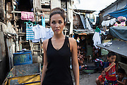 Myleene Klass, a high profile UK celebrity, TV host, violinist and pianist, poses for a portrait in an urban slum where she had visited an underprivileged mother and her family in Paranaque, Metro Manila, The Philippines on 19 January 2013. Photo by Suzanne Lee for Save the Children UK