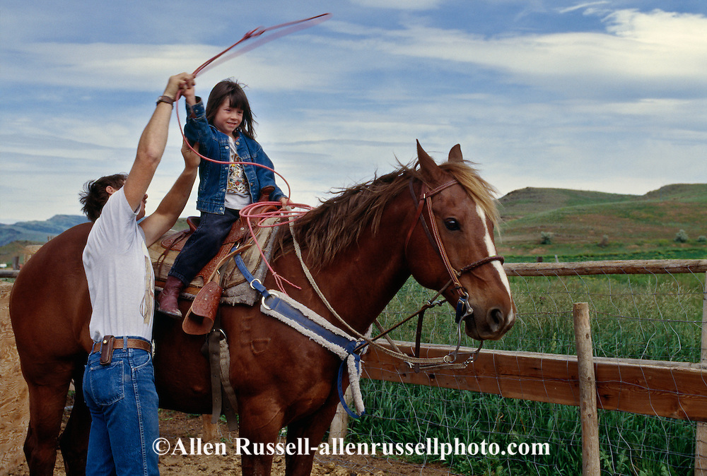 Father teaches daughter to rope, quarter horse, <br /> MODEL RELEASED