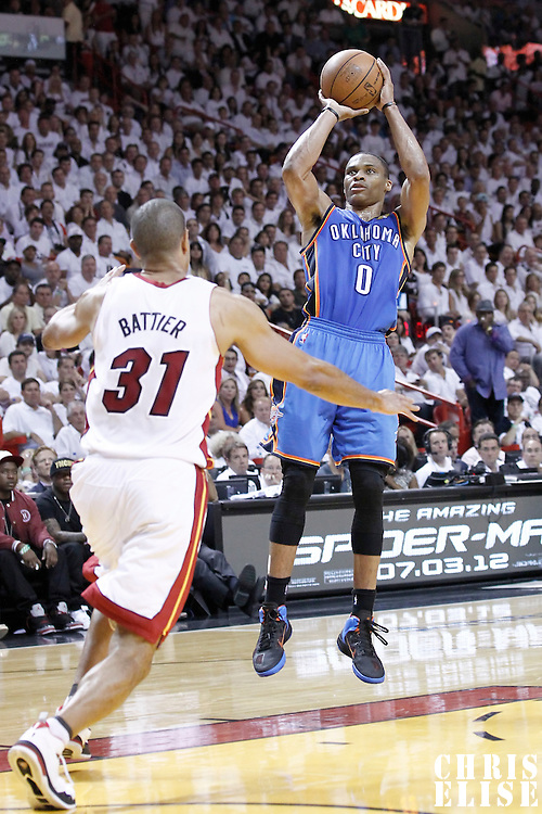 21 June 2012: Oklahoma City Thunder point guard Russell Westbrook (0) takes a jumpshot during the second quarter of Game 5 of the 2012 NBA Finals, at the AmericanAirlinesArena, Miami, Florida, USA.