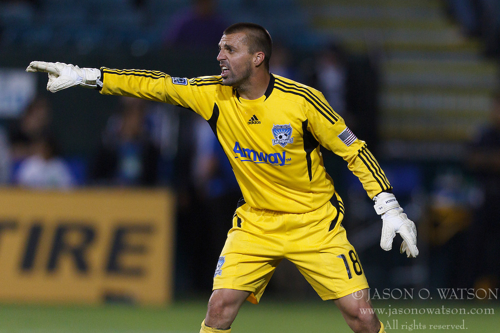 July 20, 2011; Santa Clara, CA, USA;  San Jose Earthquakes goalkeeper Jon Busch (18) directs his defense against the Vancouver Whitecaps during the second half at Buck Shaw Stadium. San Jose tied Vancouver 2-2.