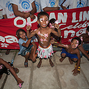 Young performer flexes his muscles after the Balayong Festival street dancing competition.The festival at the beginning of March commemorates the founding anniversary of the City of Puerto Princesa, Palawan, highlighted by balayong tree-planting, street dancing and a colourful floral parade depicting the Palawan cherry blossoms from which the festival derives its name. The Palawan cherry is one of the most popular flowering trees in Palawan and known by the locals as the Balayong, a beautiful tree that when it is in full bloom resembles the cherry blossoms of Japan.