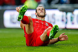 Gareth Bale of Wales (Real Madrid) reacts on the ground after being outmuscled by Jason Denayer of Belgium (Celtic) - Photo mandatory by-line: Rogan Thomson/JMP - 07966 386802 - 12/06/2015 - SPORT - FOOTBALL - Cardiff, Wales - Cardiff City Stadium - Wales v Belgium - EURO 2016 Qualifier.