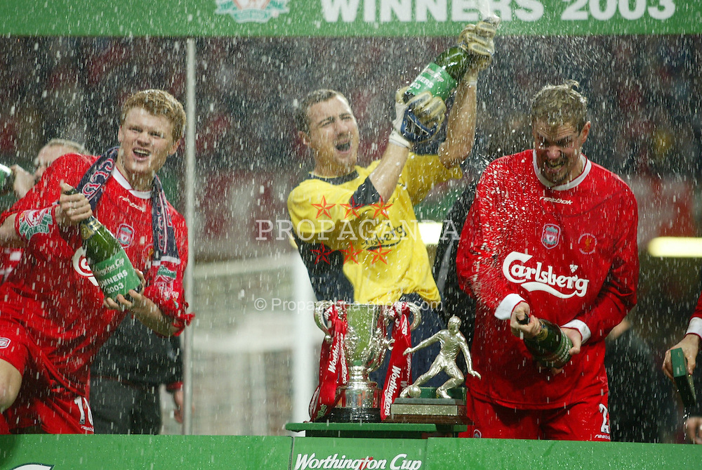 CARDIFF, WALES - Sunday, March 2, 2003: Liverpool's John-Arne Riise (l), Jerzy Dudek (c) and Stephane Henchoz (r) celebrate with champagne after beating Manchester United 2-0 to win the Worthington League Cup at the Millennium Stadium. (Pic by David Rawcliffe/Propaganda)