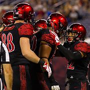 20 October 2018: San Diego State Aztecs running back Chase Jasmin (22) celebrates with his offensive line after scoring a touchdown in the second quarter. The Aztecs beat the Spartans 16-13 Saturday night at SDCCU Stadium.