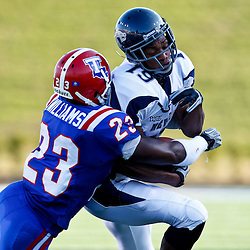 December 4, 2010; Ruston, LA, USA;  Nevada Wolf Pack wide receiver Malcolm Shepherd (19) is tackled by Louisiana Tech Bulldogs cornerback Ryan Williams (23) during the first half at Joe Aillet Stadium.  Mandatory Credit: Derick E. Hingle