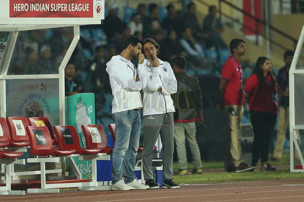 John Abrahams and Joao Carlos Pires De Deus of Northeast United FC chat during match 19 of the Hero Indian Super League between NorthEast United FC and Bengaluru FC held at the Indira Gandhi Athletic Stadium, Guwahati India on the 8th December 2017<br /> <br /> Photo by: Ron Gaunt / ISL / SPORTZPICS