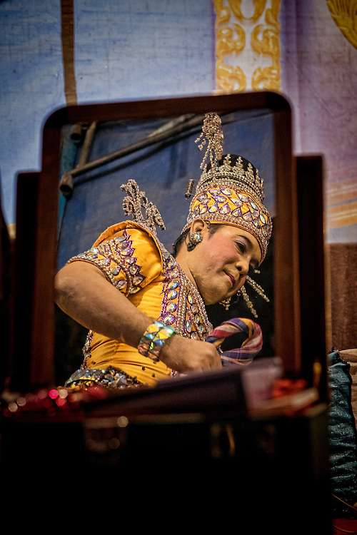 A performer backstage during a Thai Likay folk theatre performance, in Nakhon Nayok, Thailand, March 19, 2015