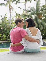 Affectionate Young Couple Relaxing in Garden