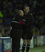 29/11/2003 - Photo  Peter Spurrier.2003/04 Nationwide Football Div 2 QPR V Sheffield Wed.Ranger's manager Ian Holloway having a word with the fourth official..