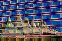 Westin Denver International Airport Hotel, Denver, Colorado USA. The tent like roof of the adjacent Jeppesen Terminal are reflected in the hotel's glass exterior.