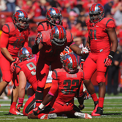 Oct 13, 2012: Rutgers Scarlet Knights defensive back Duron Harmon (32) is congratulated by teammate defensive end Marcus Thompson (48)  during NCAA Big East college football action between the Rutgers Scarlet Knights and Syracuse Orange at High Point Solutions Stadium in Piscataway, N.J.